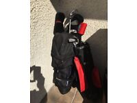 CHILDRENS golf clubs for sale with trolley