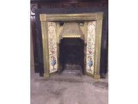 Victorian cast iron fireplace with brass/tile inlay. Separate wooden surround
