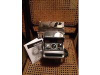 Polariod Camera, grey, great condition in box with instruction book