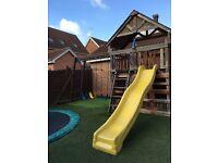 Sunray children's playcenter swing slide climbing wall monkey bar trapeze playhouse