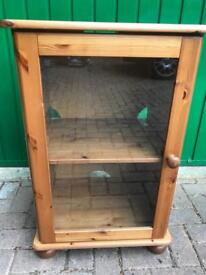 Wood cabinet with glass fronted door