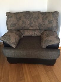 Large Leather and fabric armchair. Good condition no rips or tears.