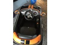 Child's electric Mini Cooper! Excellent condition, one year old and my son has now outgrown!