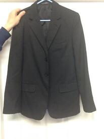 Black pinned stripped suit