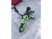 Kids Green Apollo bike with stabilisers. Currently £55 new.