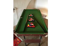 4' snooker/pool table, with two sets of balls and cues