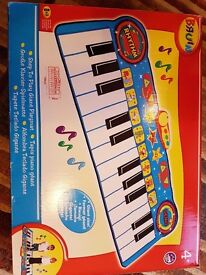 Toddler Bruin walk on piano Toy in immaculate condition.