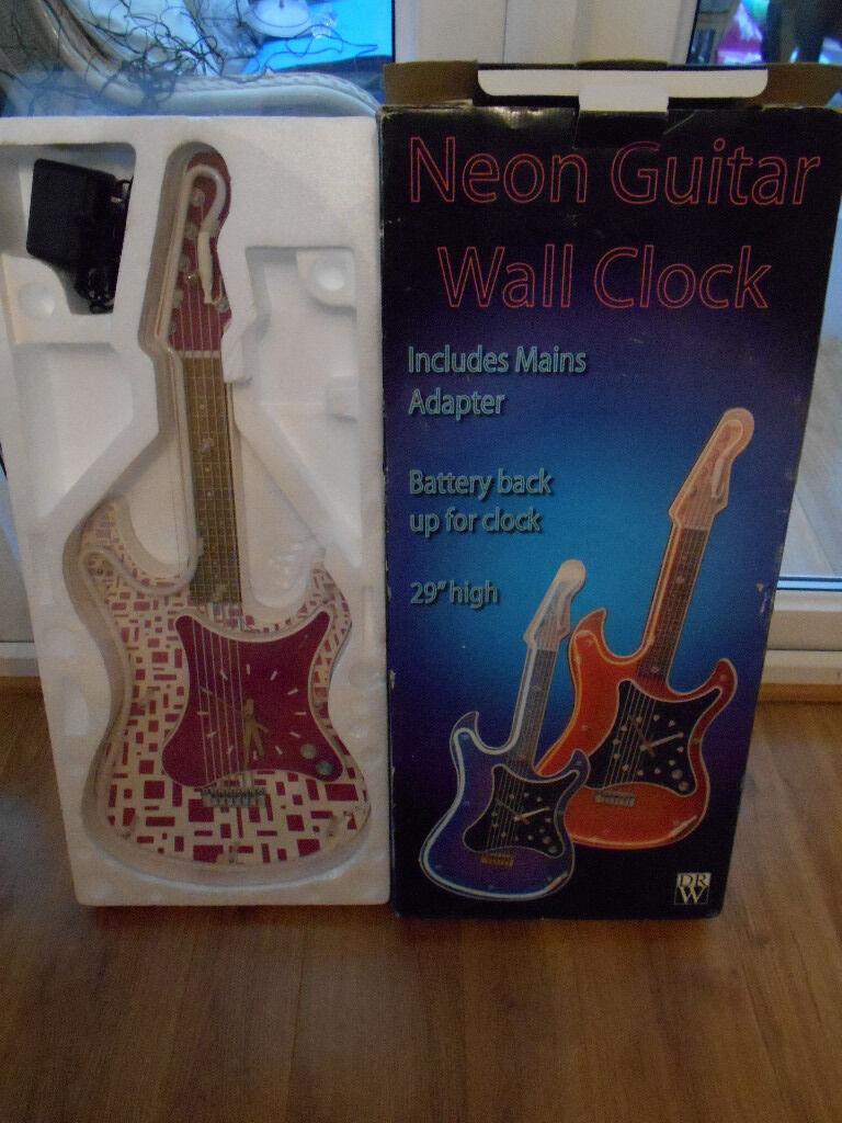 Neon guitar wall clock in rogerstone newport gumtree neon guitar wall clock amipublicfo Image collections