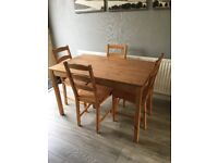 Pine effect table and 4 chairs