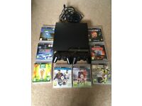 PlayStation 3 320GB with 8 Games