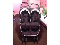 Britax b agile double buggy with car seat.