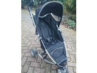 Petite Star Zia Push Chair in black with foot muff and rain cover
