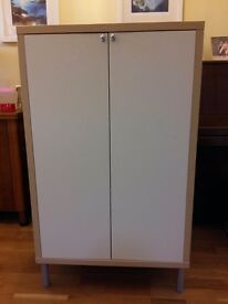 IKEA 2-door floor-standing cupboard in ash finish, four grey legs, cream coloured doors, two shelves