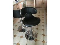 2 black leather bar stools