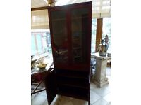 Beautiful Display cabinet in rich mahogany with two glass shelves and cupboard for storage