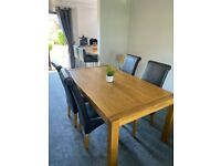 Solid oak dining table and 4 brown faux leather chairs