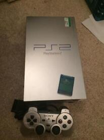 Silver Sony ps2 console setup