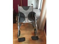 "Lightweight wheelchair for sale. 20"" wide. nearly new"