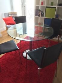 Dinning table and four chairs for sale
