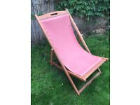 Two traditional hard wood deck chairs