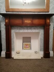 FIRE SURROUND. Solid Mahogany. Excellent condition. Has some Marquetry design. Buyer collects
