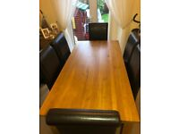 Dining room table and six chairsin brown faux leather