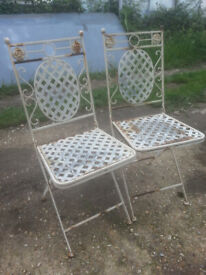 Pair of metal folding garden chairs.