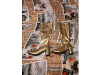 Brand new knee high boots in gold with boot bags