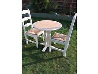Breakfast table and two chairs ( can deliver )