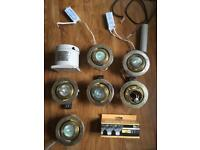 Six Illuma 12v Halogen lights, with four transformers and some spare bulbs
