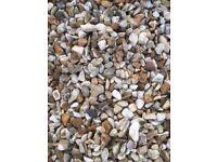 10 mm pea gravel, about 1 1/2 bulk bag worth