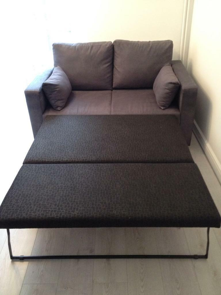 2 seater sofa bed for sale grey been used 4 times | in ipswich