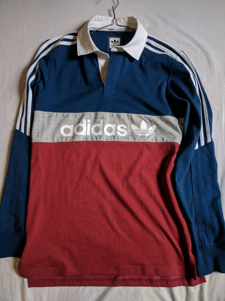 As new Adidas top. Worn once. Retro. £60 new. Small