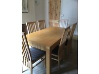 As new oak dining table and 6 chairs