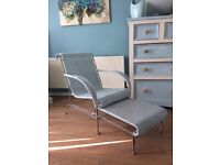 Vintage rattan and metal chair with pull out foot rest