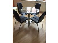 Glass Top Dining Table and 4 Faux Leather Brown Chairs from Next