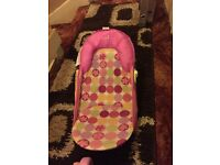 Pink baby bath seat can be used from birth