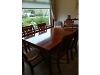 Dining Room table and six chairs including matching sideboard. Centre piece extension. Lovely design