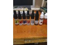 Vape pens and some fluid and atomizers