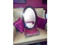 Dark wooden vintage mirror