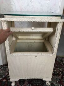 Glass topped wicker bedside table