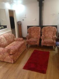 Two seater sofa and two wingback chairs