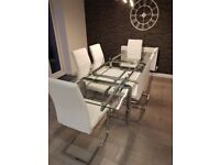 GLASS EXTENDABLE DINING TABLE AND LEATHER CHAIRS