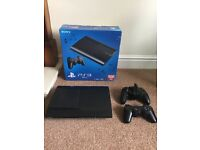 PlayStation 3 with 2 controllers, cables and box