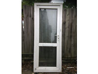 White UPVC door with obscure glazing top and bottom,.