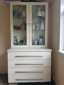 Storage drawers with separate glass cabinet