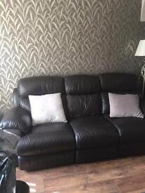 Lovely three seater brown leather reclining settee