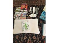 Nintendo Wii with controls, Wii Fit board and game, game accessories and 5 games