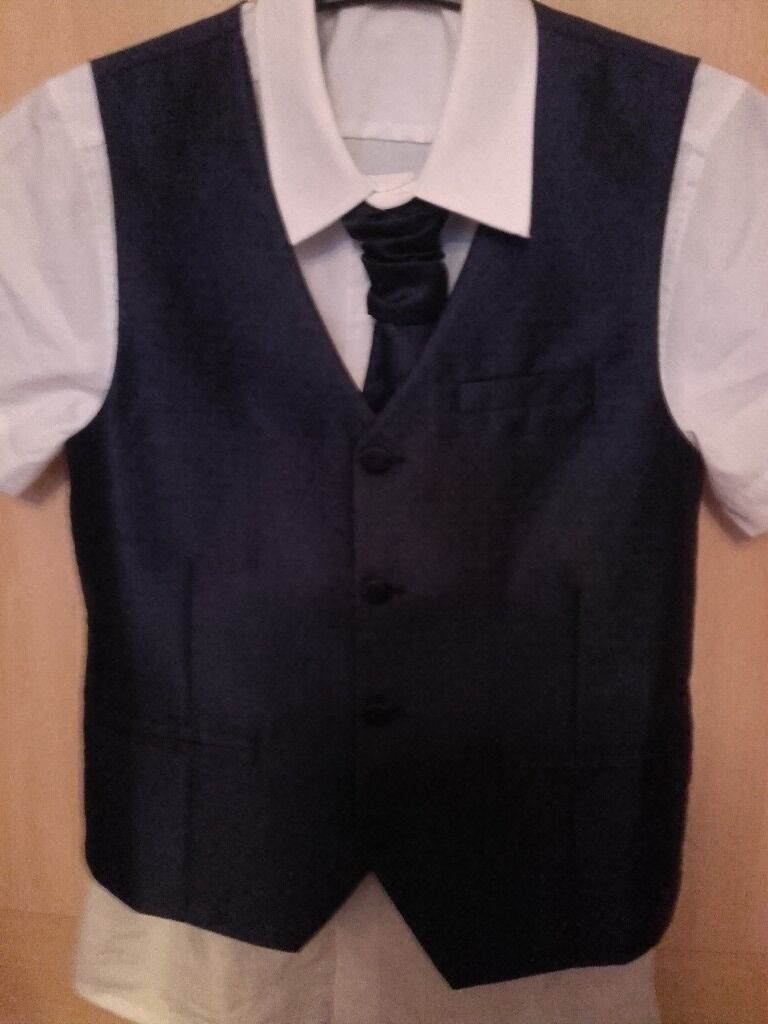 Age 9 waistcoat and tie set (from Next) and shirt from Matalan (age 10) only worn a few hoursin Saltash, CornwallGumtree - Age 9 shiny blue waistcoat and tie set from Next and white shirt (from Matalan age 9). Only worn for a few hours. Ideal for a wedding