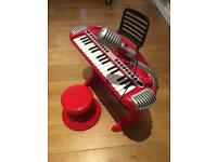 Kids electric piano with microphone good condition